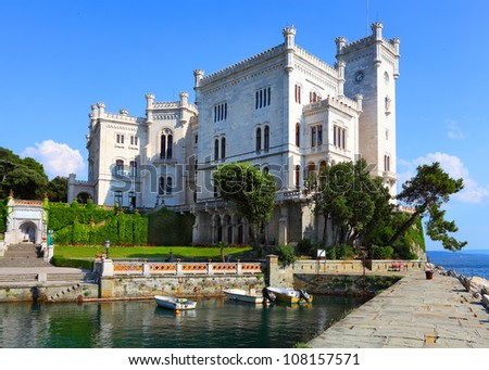 The Miramare Castle in Trieste, a nineteenth-century castle of white stone perched above the Adriatic sea.  Italy. - stock photo