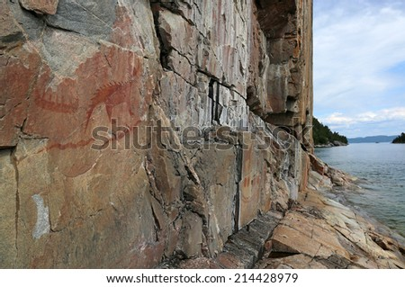 The Mishibizhiw or Great Lynx, along with canoes and serpents, are part of the Agawa Rock Pictographs.  The site is found in Lake Superior Provincial Park, in Ontario, Canada.  - stock photo