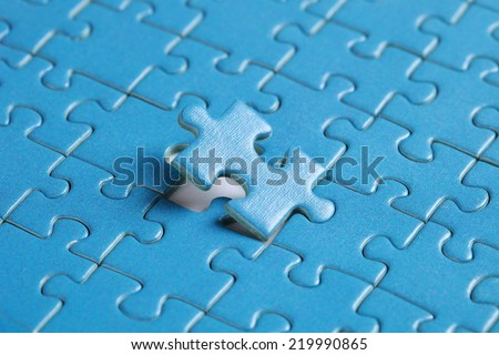 The missing piece of puzzle, success, teamwork and finishing or ending - stock photo