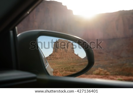 The mittens. Mesa. view from rear mirror at Monument Valley. Navajo Tribal Park. Arizona USA. - stock photo