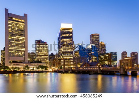 The mix of modern and historic architecture of Boston in Massachusetts, USA at sunset showcasing its skyline at Boston Harbor and Financial District.