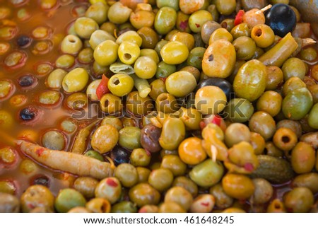 The mixed olives with sauce and vegetables