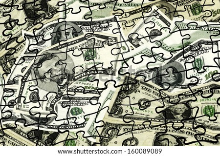 The mixture of money denominations makes a good puzzle overlay for financial stories. - stock photo