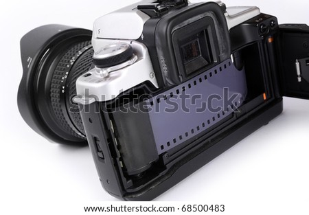 The 35mm slr camera with opened back side. - stock photo