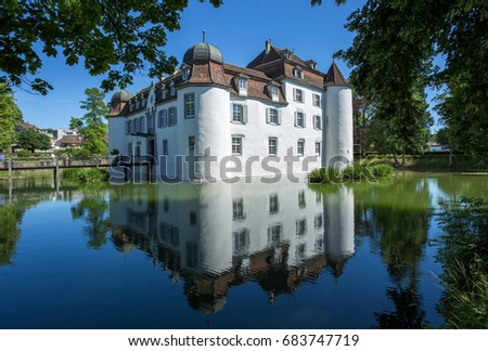 The moated castle (built in the 13th century) in Bottmingen, Basel, Switzerland