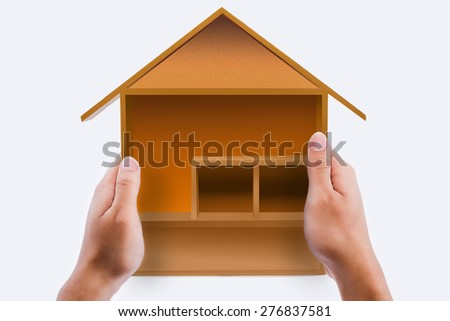 The model house in hands isolated on white background - stock photo