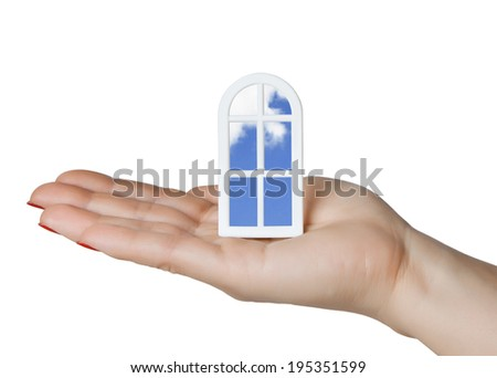 The model is beautiful plastic Windows with views of the sky in the palm - stock photo