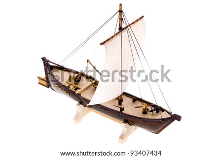 The model of the ship isolated on a white background. The ship is made of a tree
