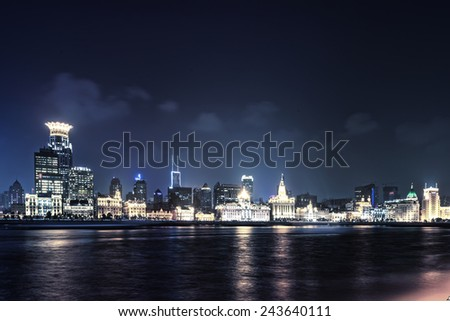 The modern city landscape in the middle of the night - stock photo