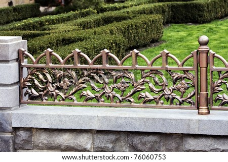 The Modern forged decorative fence with element casting . - stock photo