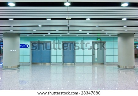 the modern hall with three doors - stock photo