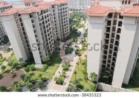 The modern high rise buildings with gardens and playground in a residential aparment block. - stock photo