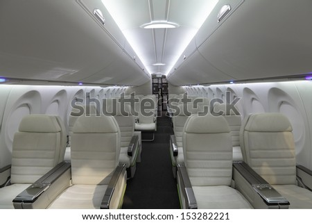 The modern interior of the airliner - stock photo