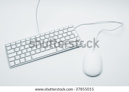 The modern keyboard and the mouse for a computer - stock photo