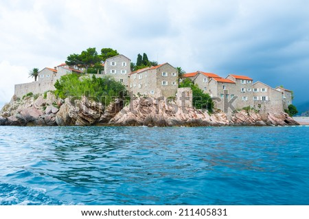 The modern luxury resort located on the small islet, that was a tiny fishing village, Sveti Stefan, Montenegro. - stock photo