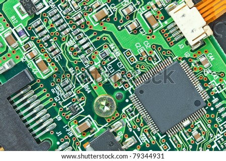 The modern printed-circuit board with electronic components macro background - stock photo