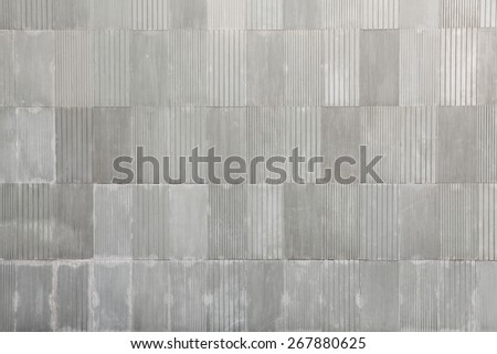 The modern rectangle Concrete Ribbed Wall with a repetitive line design - stock photo