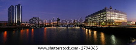 The modern skyline of Glasgow's River Clyde at dusk - stock photo
