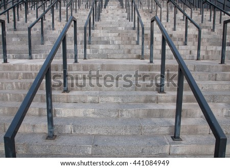 The modern stone stairway with metal handrails   - stock photo