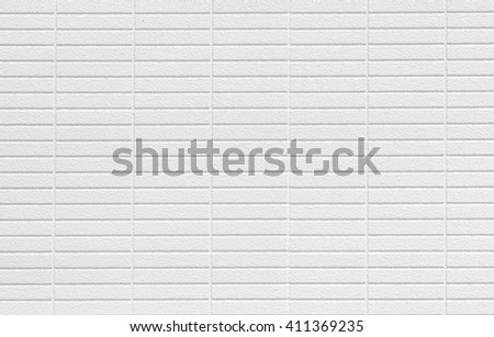 The modern white concrete tile wall background