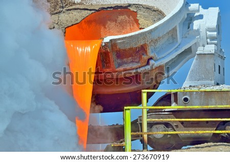 The molten steel is poured into the slag dump - stock photo