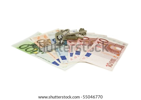 The money and the keys to the apartment or house isolated on white background