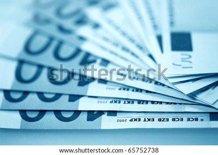 The money euro. Bundle of bank notes in bllue duotone - stock photo