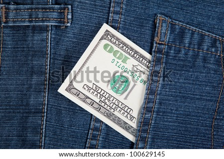 The money in a pocket of a denim - stock photo