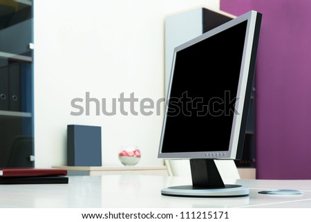The monitor on a desk at modern office - stock photo