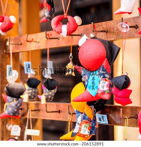 the monkey doll called sarubobo at a shrine in Takayama, Japan. The villager believe that this doll is the sign of healthy for their children. - stock photo