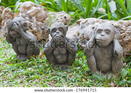 the monkey dolls are molded using hand action close ears,eyes and mouth - stock photo