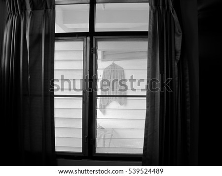 The monochrome of curtain and mirror window