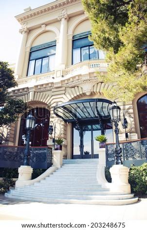 The Monte Carlo Casino is landmark in Monte Carlo, Monaco, Cote de Azul, France, Europe. It includes a casino, the Grand Theatre de Monte Carlo, and the office of Les Ballets de Monte Carlo. - stock photo