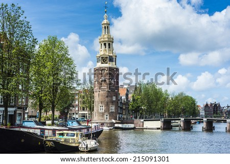 The Montelbaanstoren tower on Oudeschans canal in Amsterdam, Netherlands, built in 1516 for the purpose of defending the city. - stock photo