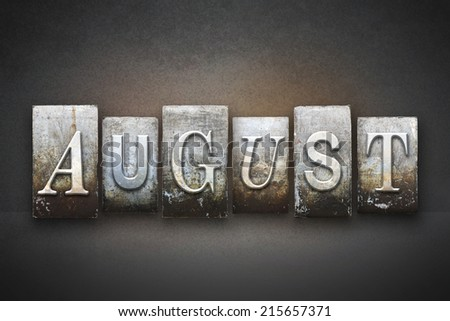 The month AUGUST written in vintage letterpress type - stock photo