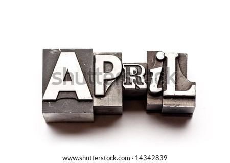 "The month of ""April"" done in letterpress type on a white paper background. Part of a calendar series. - stock photo"