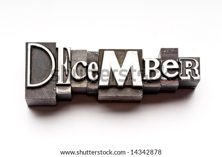 "The month of ""December"" done in letterpress type on a white paper background. Part of a calendar series. - stock photo"