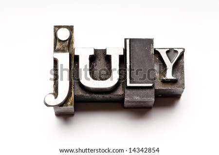 "The month of ""July"" done in letterpress type on a white paper background. Part of a calendar series. - stock photo"