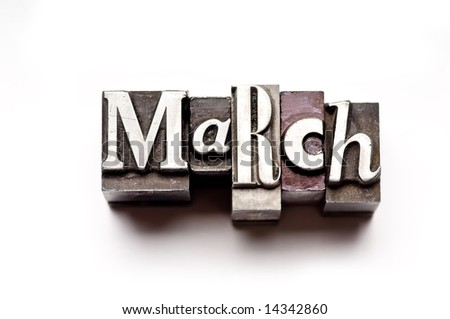 "The month of ""March"" done in letterpress type on a white paper background. Part of a calendar series. - stock photo"
