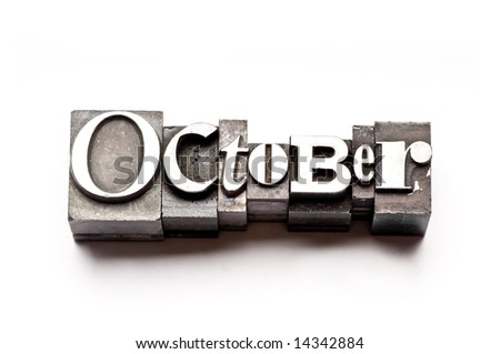 "The month of ""October"" done in letterpress type on a white paper background. Part of a calendar series. - stock photo"