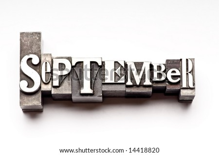 "The month of ""September"" done in letterpress type on a white paper background. Part of a calendar series. - stock photo"