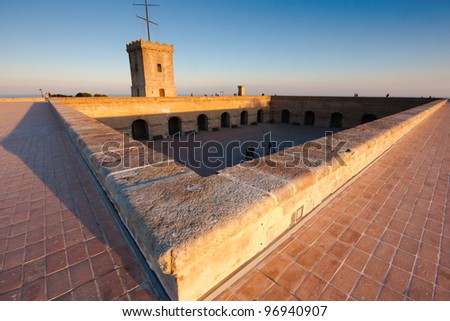 The Montjuic fortress in Barcelona at sunset - stock photo