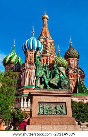 The Monument to Minin and Pozharsky is a bronze statue on Red Square in Moscow, Russia, in front of Saint Basil's Cathedral.  - stock photo