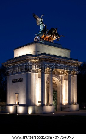 The monument to Wellington in the middle of the Hyde Park Corner roundabout, London, at night. - stock photo