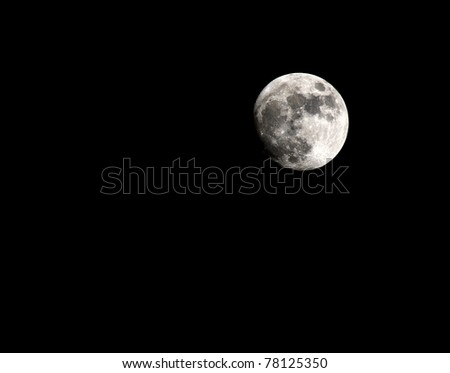 the moon in the black night sky