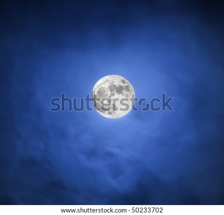 The moon in the dark blue night sky
