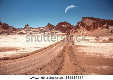The moon in the Moon Valley in Atacama Desert, Chile - stock photo