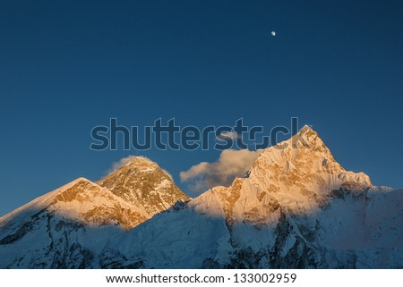 The Moon, Mt. Everest (8848 m), and Nuptse (7864 m) in the evening (view from Kala Patthar) - Nepal, Himalayas - stock photo