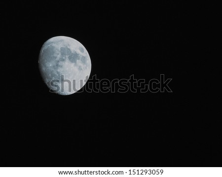 The moon over dark black sky at night