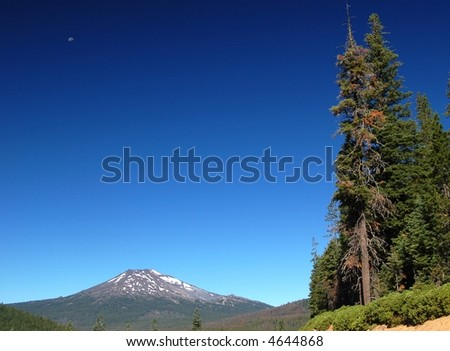 The moon over Mount Bachelor in Oregon - stock photo